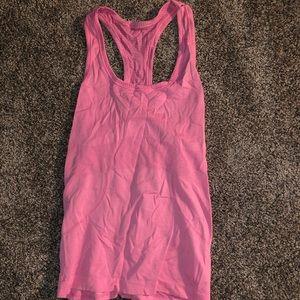 Pink lululemon tank. Gently used. Size 4